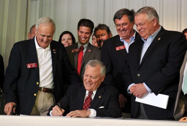 Deal Signs Gun Bill