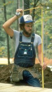 carpenter with tape measure photo